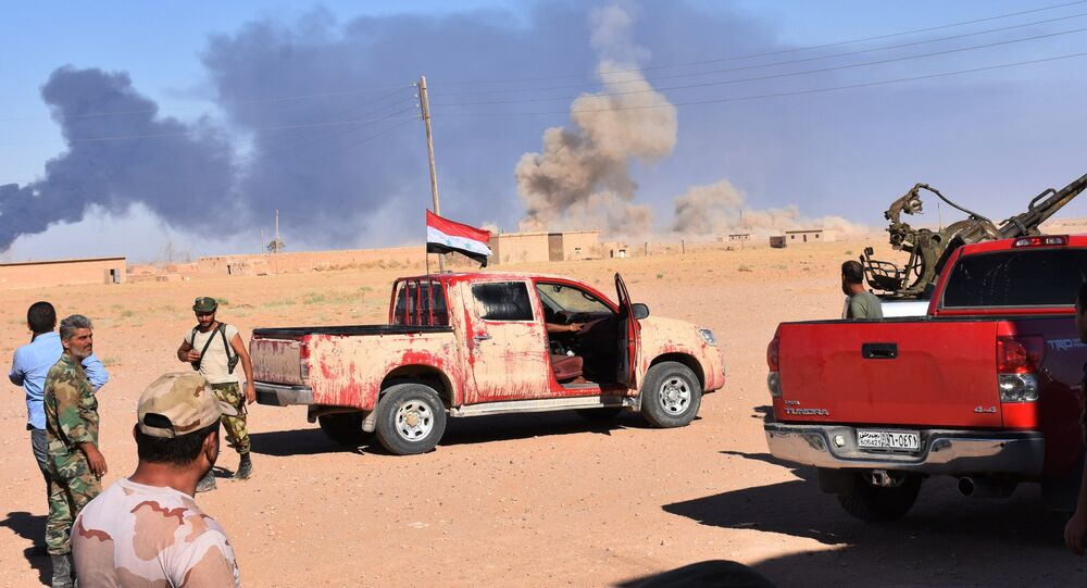 Smoke billows as Syrian government forces advance in Al-Shula on the southwestern outskirts of Deir Ezzor on September 8, 2017