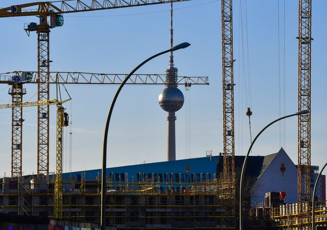 Cranes frame Berlin's TV Tower at a constrution site near the city's famed East Side gallery, on March 24, 2017