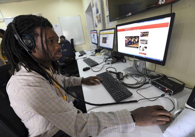 A British Broadcasting Corporation (BBC) programmer Busayo Iruemiode checks a website in Pidgin in Lagos, on August 18, 2017