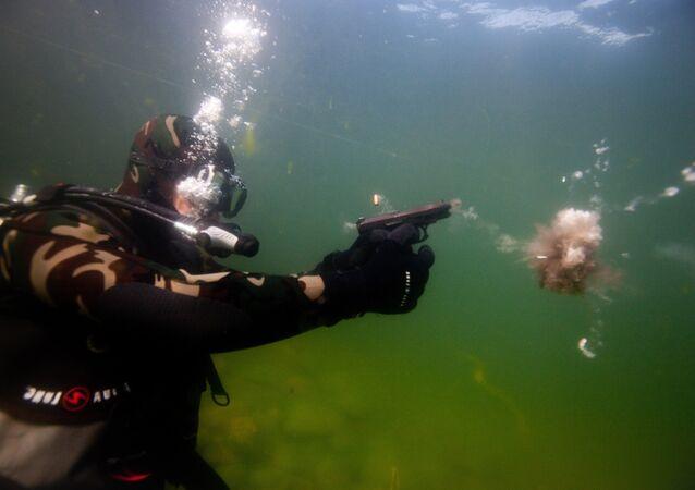Firing a GSh-18 underwater pistol during an exercise at Baikal. Russian MHA's internal troop divers train at the Severobaikalsk marine training center