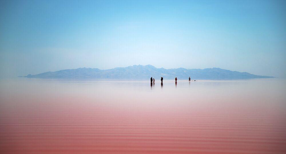 Iranians spend time in Urmia Lake near Urmia, North-western Iran (File)