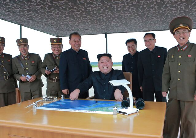 North Korean leader Kim Jong Un inspects a long and medium-range ballistic rocket launch drill in this undated photo released by North Korea's Korean Central News Agency (KCNA) in Pyongyang on August 30, 2017