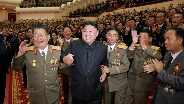 North Korean leader Kim Jong Un reacts during a celebration for nuclear scientists and engineers who contributed to a hydrogen bomb test, in this undated photo released by North Korea's Korean Central News Agency (KCNA) in Pyongyang on September 10, 2017 - Sputnik International