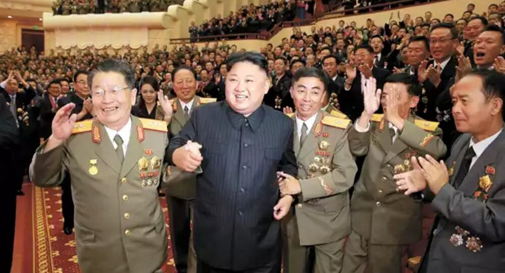 DPRK leader Kim Jong-un, flanked by the county's top nuclear-weapons officials, celebrates the country's weapons and ballistic missile achievements (KCNA image)
