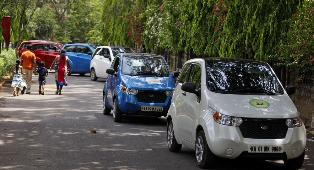 Owners drive Mahindra Reva automatic electric cars in a row during a rally organized to create awareness about energy efficient and alternative modes of personal transport in Bangalore, India, Saturday, June 28, 2014