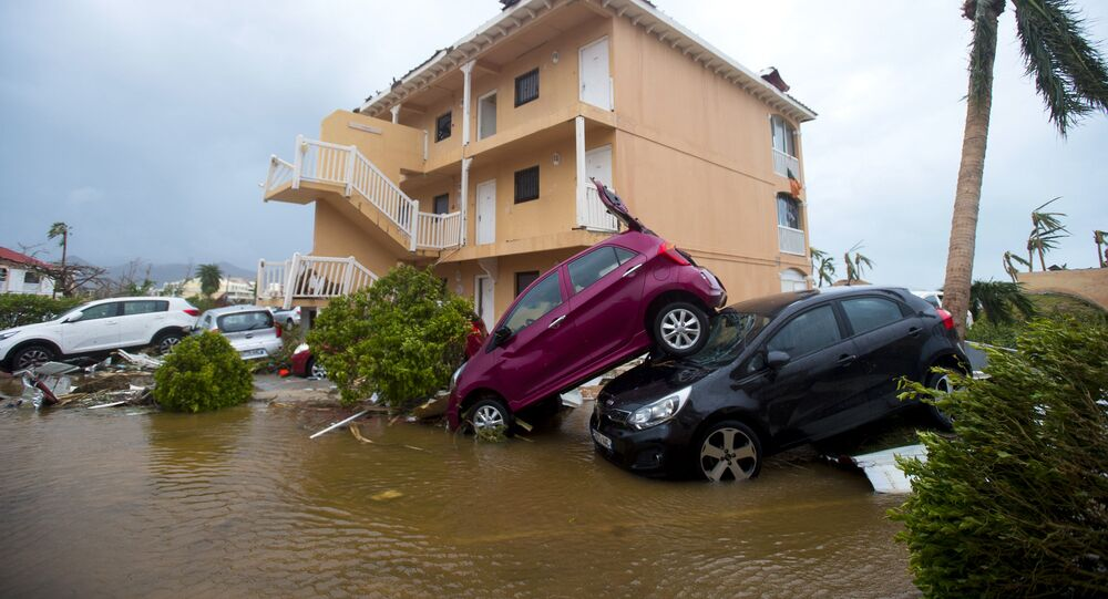 A photo taken on September 6, 2017 shows cars piled on top of one another in Marigot, near the Bay of Nettle, on the French Collectivity of Saint Martin, after the passage of Hurricane Irma