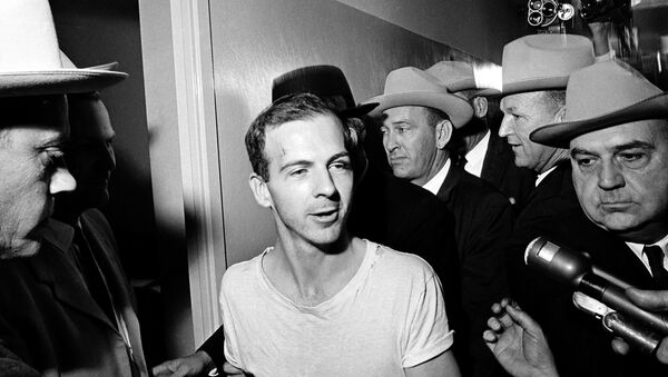 Surrounded by detectives, Lee Harvey Oswald talks to the press as he is led down a corridor of the Dallas police station for another round of questioning in connection with the assassination of US President John F. Kennedy, November 23, 1963. - Sputnik International