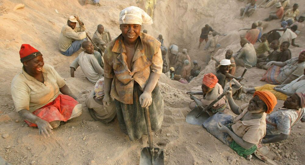 In this file photo taken Wednesday, Nov. 1, 2006 gangs of illegal miners dig for diamonds in Marange, eastern Zimbabwe.