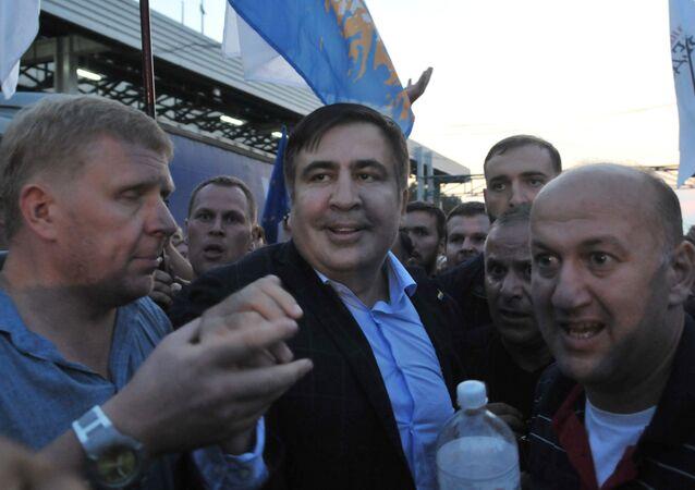 Mikheil Saakashvili, center, Georgia's ex-president and former governor of the Odessa region, at the Shehyni checkpoint on the Ukrainian-Polish border