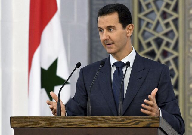 Syrian President Bashar Assad speaks to dozens of Syrian diplomats, in Damascus, Syria (File)