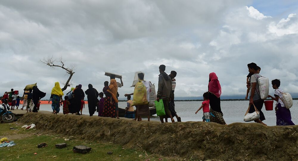 Rohingya Muslim refugees arrive from Myanmar after crossing the Naf river in the Bangladeshi town of Teknaf