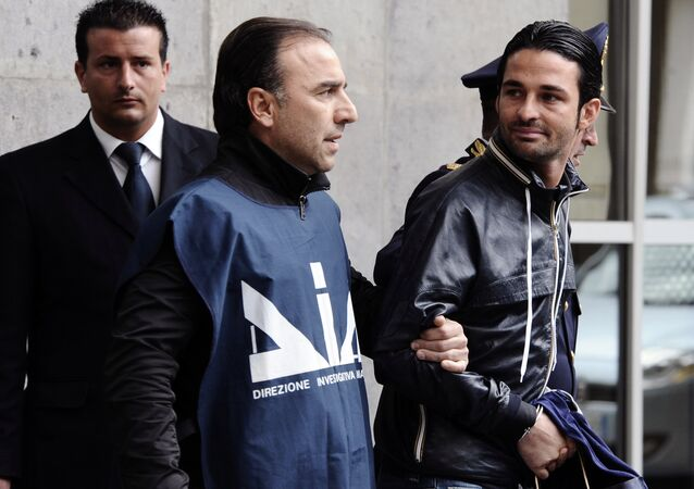 Paolo Schiavone, right, is escorted by Police officers after being arrested at Naples's port, Italy. (File)