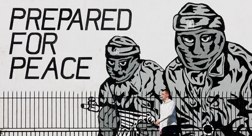 A man walks past a mural from the loyalist terror group the Ulster Volunteer Force in Belfast, Northern Ireland, Thursday, May, 3, 2007.