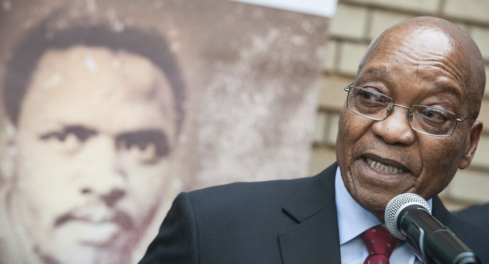 South African President Jacob Zuma, right, addresses the media in Pretroia, South Africa Tuesday, Sept 12, 2017 on the 40th anniversary of the death of anti-apartheid activist Steve Biko, back.
