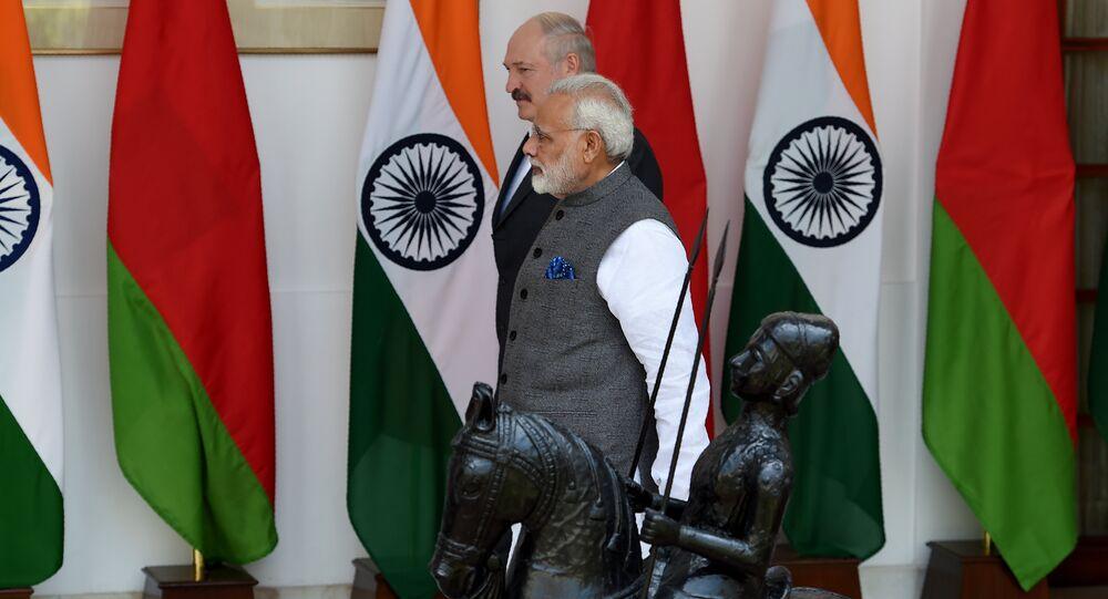 Indian Prime Minister Narendra Modi (R) walks with President of Belarus Alexander Lukashenko before their meeting in New Delhi on September 12, 2017