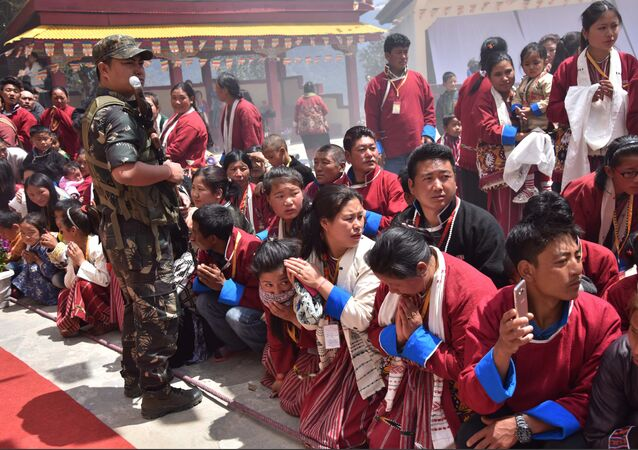 Buddhist followers wait for exiled Tibetan spiritual leader the Dalai Lama at Urgelling Monastery, the birthplace of the 6th Dalai Lama, in the district of Tawang in India's north-eastern state of Arunachal Pradesh on April 9, 2017