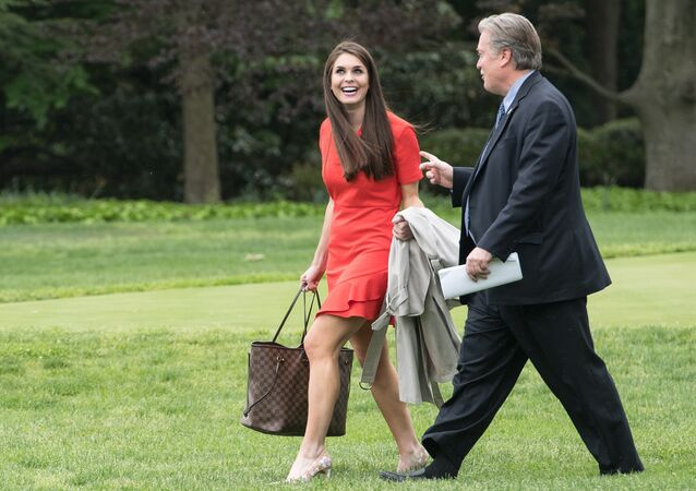 White House Director of Strategic Communications Hope Hicks (L) and Chief Strategist Steve Bannon (R) walk to board Marine One as US President Donald Trump departs the White House for Harrisburg, Pensylvannia, where he will hold a rally on the 100th day of his presidency on April 29, 2017 in Washington, DC