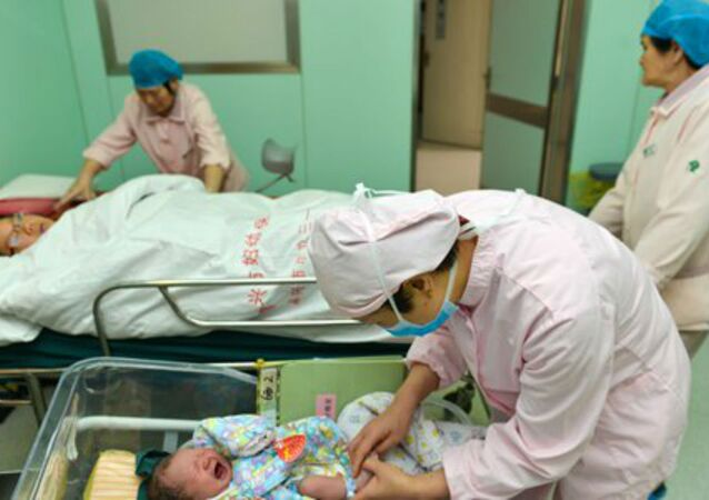 Woman lies dazed after painful childbirth