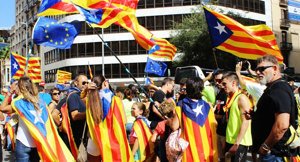 Participants in the rally in the streets of Barcelona support the referendum for independence and Catalonia's secession from Spain, which is timed to National Day of Catalonia