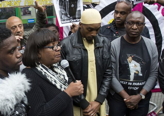 Member of Parliament, Diane Abbott, left, Ginario Da Costa, right, the father of Edson Da Costa, and Esa Charles, father of Rashan Charles who died after contact with police last Saturday, arrives at a protest over his death at Stoke Newington police station, London, Saturday July 29, 2017.