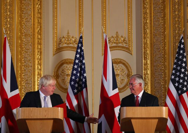 Britain's Foreign minister Boris Johnson (L) and US Secretary of State Rex Tillerson take part in a joint press conference after their meeting on Libya, at Lancaster House in London
