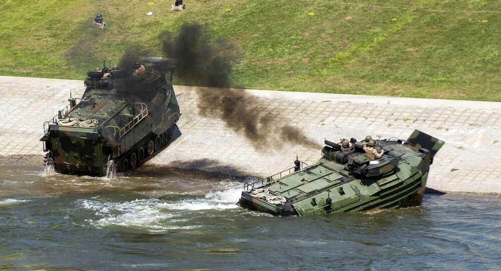This Sept. 6, 2016, photo released by the U.S. Marine Corps shows Marines with the 2nd Amphibious Assault Battalion aboard AAV-7 Amphibious Assault vehicles during an exercise on the Cumberland River in Nashville, Tenn.