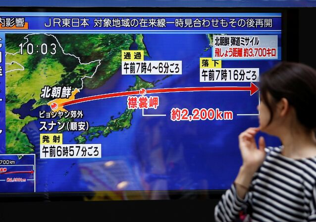 A passerby looks at a TV screen reporting news about North Korea's missile launch in Tokyo, Japan September 15, 2017