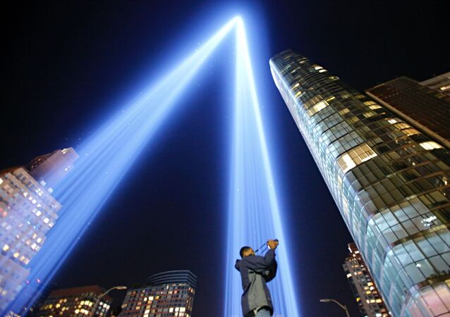 As man takes a pictures as the The 'Tribute in Light' illuminates the night sky, on September 10, 2017 in New York City, on the eve of the anniversary of the September 11, 2001 terror attacks.