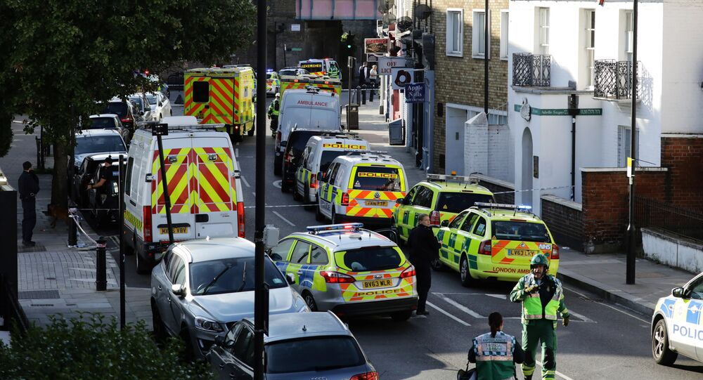 Police vehicles line the street near Parsons Green tube station in London, Britain September 15, 2017