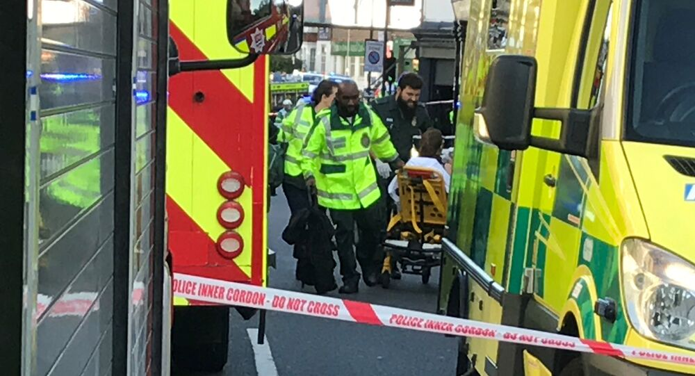 Emergency personnel attend to a person after an incident at Parsons Green underground station in London, Britain, September 15, 2017