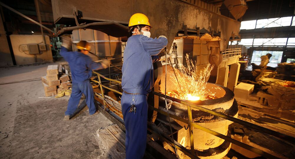 This Aug. 11, 2009 photo shows laborers working at Huaxi No. 2 steel and iron construction material company in Huaxi, Jiangsu Province, China