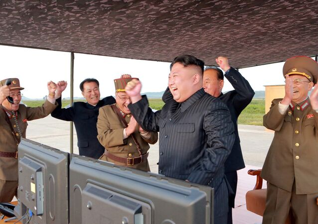 North Korean leader Kim Jong Un guides the launch of a Hwasong-12 missile in this undated photo released by North Korea's Korean Central News Agency (KCNA) on September 16, 2017