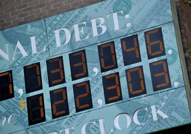(File) Detail of the National Debt Clock, a billboard-size digital display showing the increasing US debt, on Sixth Avenue August 1, 2011 in New York