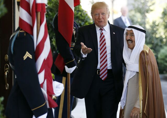In this Thursday, Sept. 7, 2017 file photo, President Donald Trump, center, gestures as he greets the Amir of Kuwait Sheikh Sabah Al Ahmad Al Sabah as he arrives at the White House in Washington. Kuwait says it will expel North Korea's ambassador and four other diplomats from its embassy in Kuwait City.
