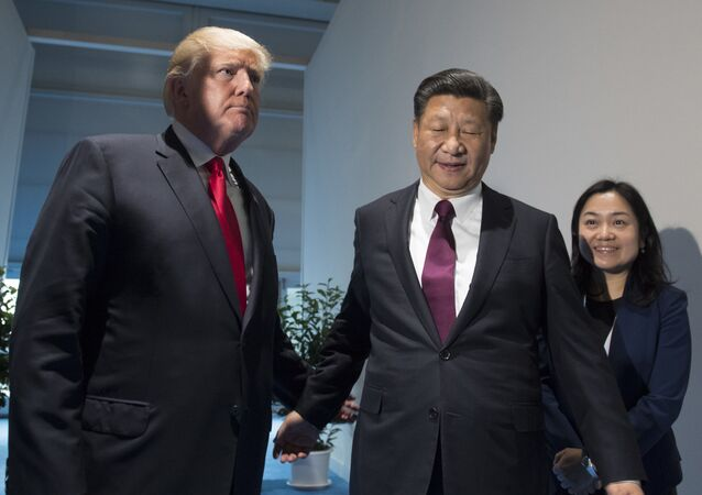 US President Donald Trump and Chinese President Xi Jinping, right, arrive for a meeting on the sidelines of the G-20 Summit in Hamburg, Germany, Saturday, July 8, 2017