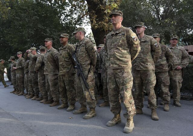 US and NATO soldiers take part in a ceremony to commemorate the Sept. 11, 2001, attack on the World Trade Center in New York, in Resolute Support 'Green Zone' headquarters of Kabul, Afghanistan, Monday, Sept. 11, 2017