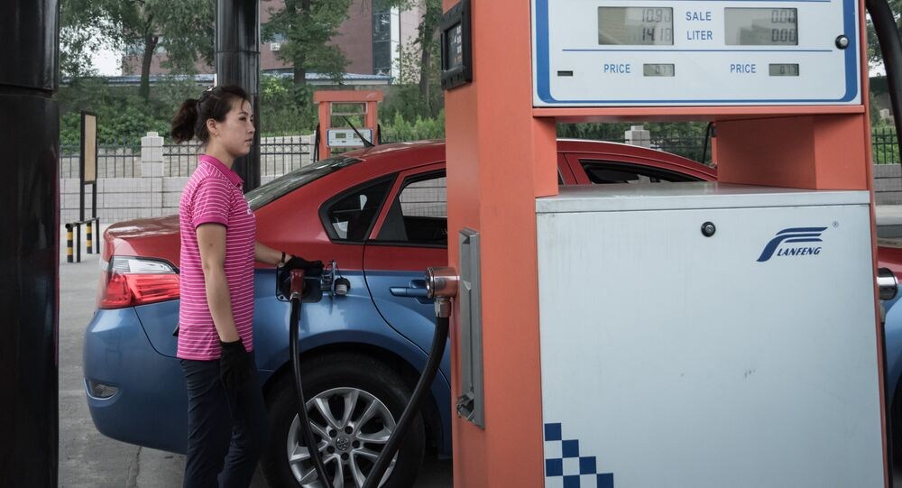In this photo taken on July 21, 2017, a petrol pump attendant fills up a taxi with gasoline at a fuel station in Pyongyang