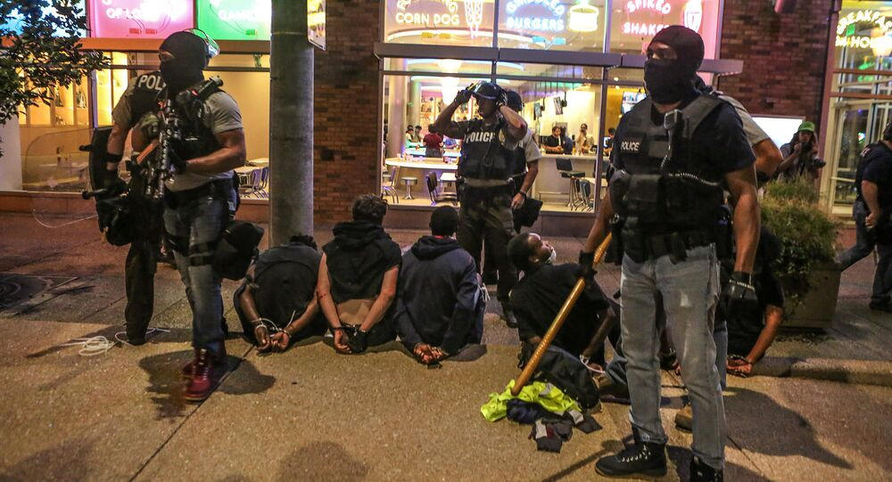 Police detain protesters arrested for causing damage to local businesses during the second night of demonstrations after a not guilty verdict in the murder trial of former St. Louis police officer Jason Stockley, charged with the 2011 shooting of Anthony Lamar Smith, who was black, in St. Louis, Missouri, U.S., September 16, 2017
