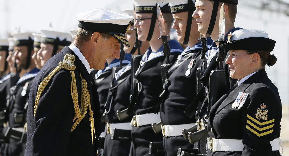 Admiral Sir George Zambellas, left, inspects the guard before he presents medals to Navy personnel involved in the UK's response to the Ebola crisis, in Portsmouth, England, Thursday, Sept. 10, 2015.