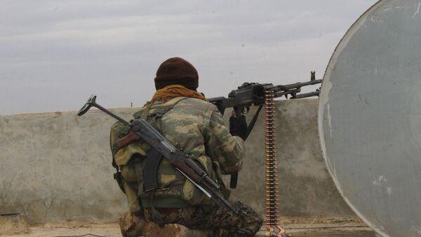 A Syrian Democratic Forces fighter - Sputnik International