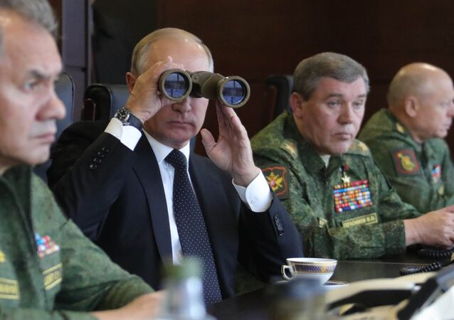 President Vladimir Putin seen while surveying the Russia and Belarus Union State armed forces activities at the main stage of the joint strategic exercises Zapad-2017) on the Luzhsky range