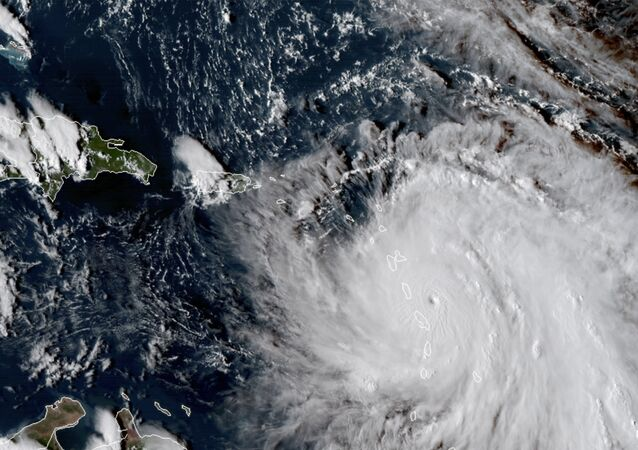 This Monday, Sept. 18, 2017, GOES East satellite image provided by NASA taken at 20:30 UTC, shows the eye of Hurricane Maria as it nears Dominica