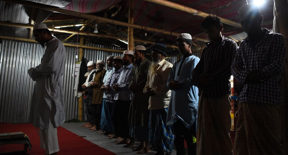 In this photograph taken on September 14, 2017, Rohingya Muslim refugees offer prayers inside a shelter in the Nepali capital Kathmandu
