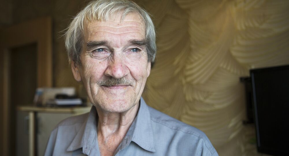 In this Thursday, Aug. 27, 2015 photo former Soviet missile defense forces officer Stanislav Petrov poses for a photo at his home in Fryazino, Moscow region, Russia, Thursday, Aug. 27, 2015.