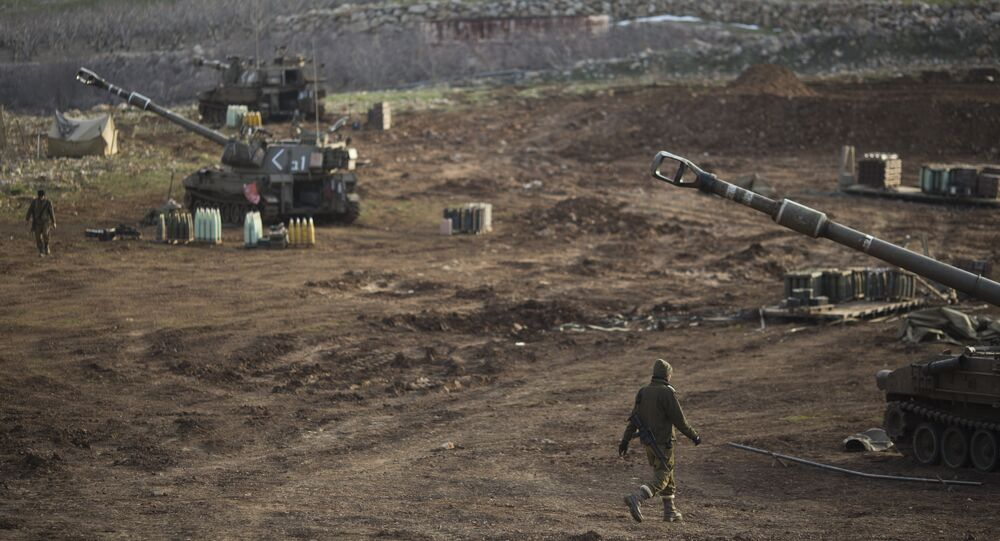 Israeli soldiers walk next to mobile artillery units in the Israeli-occupied Golan Heights near the border with Syria. (File)