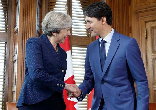 Canada's Prime Minister Justin Trudeau (R) shakes hands with Britain's Prime Minister Theresa May during a meeting in Trudeau's office on Parliament Hill in Ottawa, Ontario, Canada, September 18, 2017.