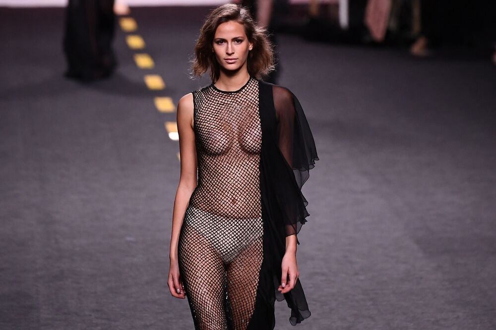 Katie eary model takes to the catwalk exposing her bare breasts