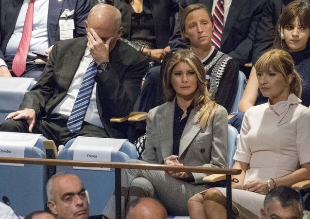 White House Chief of Staff John Kelly, left, reacts as he and first lady Melania Trump listen to U.S. President Donald Trump speak during the 72nd session of the United Nations General Assembly at U.N. headquarters