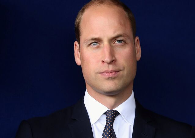Britain's Prince William poses for a photograph as he visits Aintree University Hospital in Liverpool, Britain, September 14, 2017.