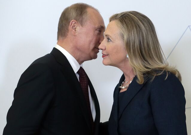 File photo taken on Saturday, Sept. 8, 2012, Russian President Vladimir Putin, left, meets U.S. Secretary of State Hillary Rodham Clinton on her arrival at the APEC summit in Vladivostok, Russia.